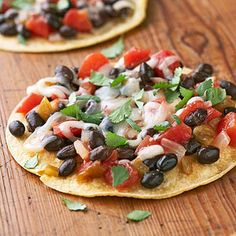 Your family will enjoy building their own Mexican-style individual pizzas from black beans, salsa, and shredded cheese. Jalapeno chile peppers will add a spicy kick to this recipe.