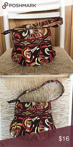 Vibrant Vera Bradley bag very versatile. Vera Bradley bag in excellent shape.Everyone deserves a cute new bag.! Treat yourself! Vera Bradley Bags