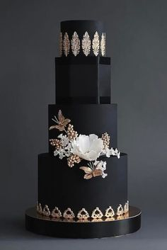 Black wedding cake with gold appliques wedding cakes cakes elegant cakes rustic cakes simple cakes unique cakes with flowers Black And White Wedding Cake, Black Wedding Cakes, Elegant Wedding Cakes, Elegant Cakes, Beautiful Wedding Cakes, Gorgeous Cakes, Wedding Cake Designs, Pretty Cakes, Gold Wedding