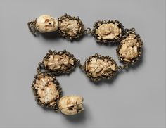 Rosary, ca. 1500–1525, German. Ivory, silver, and partially gilded mounts. Overall: 24 11/16 x 2 1/8 x 1 3/4 in. (62.7 x 5.4 x 4.5 cm) Top Terminal: 1 5/8 x 1 5/16 x 1 1/2 in. (4.2 x 3.4 x 3.8 cm) 2nd bead: 2 1/16 x 1 11/16 x 1 in. (5.2 x 4.3 x 2.6 cm) 3rd bead: 2 3/16 x 1 7/8 x 11/16 in. (5.6 x 4.7 x 1.7 cm) 4th bead: 2 5/16 x 1 15/16 x 1 in. (5.8 x 4.9 x 2.6 cm) 5th bead: 2 9/16 x 2 x 1 1/16 in. (6.5 x 5.1 x 2.7 cm) 6th bead: 2 1/2 x 1 13/16 x 7/8 in. (6.3 x 4.6 x 2.2 cm) 7th bead: 2 3/4 x…