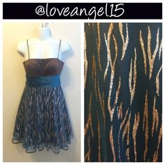 """Cocktail Dress Brown, blue, and gold cocktail dress. This is a absolutely must have! It has a see through under layer. Can be tied in the back. Reasonable offers will be accepted, please use the """"offer"""" button. TRADESPP   Measurements: Bust-28 inches Waist-22 inches Length (including strap)-36 inches. Jump Apparel Dresses"""