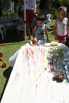 Art Party Activities. Painting with Cars. Toy Cars, Trucks, Motorbikes wheels rolled in paint and sent down a ramp covered in butchers paper. The top of egg cartons were used to hold paint.