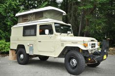 This rare Land Cruiser is based on the troop carrier edition, and features a Westfalia type pop-top camper, so it can sleep up to four people.