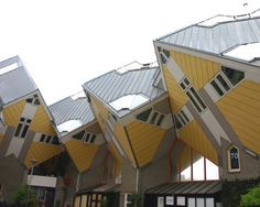 Cube House (Rotterdam, Netherlands Architect Piet Blom tipped a conventional house forty-five degrees and rested it upon a hexagon-shaped pole so that three sides face down and the other three face the sky.)