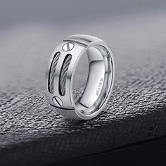 This 8 mm wide silver/black cable titanium ring for men, lightweight, hypoallergenic.Double cables inlay and screw design with high finish and domed style make the ring very comfortable. Titanium Rings For Men, Tungsten Rings, Silver Man, Silver Rings, Nice Jewelry, Black Mamba, Men's Accessories, Fashion Rings, Cable