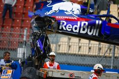 Marshals remove the damaged car of Brendon Hartley, Toro Rosso from the circuit as the gearbox hangs off the back. Photo by Andy Hone / LAT Images on May 2018 at Spanish GP. Formula One World Championship photos. Grand Prix, Formula One, World Championship, First World, F1, Circuit, Monster Trucks, How To Remove, Vans