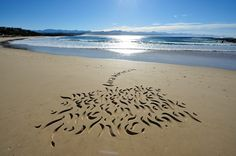 Beach calligraphy by Andrew van der Merwe (poem by Lara Kirsten)