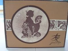 Stampin' handmade card by jules4me  ... browns ... large circle for silhouette of kneeling geisha with fan ...