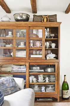 An avid collector, Jennifer stores pieces in plain sight in a glass-encased living room-cabinet. She found the large Champagne bottle at a garage sale Home Living Room, Living Room Designs, Living Room Furniture, Living Room Decor, Dining Rooms, Shabby Chic Kitchen, Shabby Chic Homes, Shabby Chic Decor, Saltbox Houses