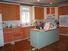 Removing thermofoil from cabinets with heat gun and painting melamine doors