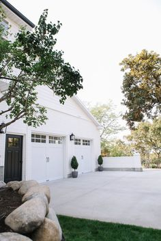Outdoor lighting, potted plants and other exterior details can draw out the house Exterior Design, Interior And Exterior, Garage Exterior, Alpine Modern, Door Makeover, Garage Makeover, Exterior Makeover, Exterior Lighting, House Goals