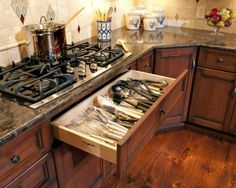 I think this is a wonderful idea!  I used to have all my spoons and spatulas clear across the kitchen! It's not going to work in the new house unless we get some new appliances though :(