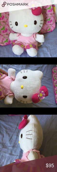 • nwt large hello kitty Plush • Great hello kitty Plush. Large size for display, about a foot tall. Has a flower on her bow and is wearing a cute flower petal skirt.   Never been used, displayed, or flawed. Nwt. An older style not made anymore. Sanrio Other