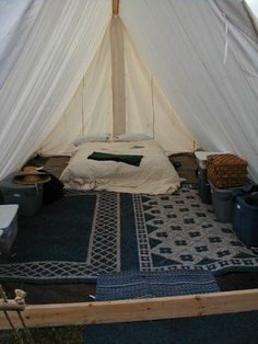 tent interior: wicker/burlap mats for easy cover and clean up. and you can paint them if you want.