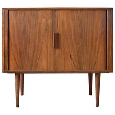Kai Kristiansen Rosewood Cabinet with Tambour Doors, FM Møbler, 1960 | From a unique collection of antique and modern cabinets at https://www.1stdibs.com/furniture/storage-case-pieces/cabinets/