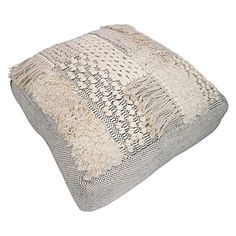 Complement your tribal-inspired space with the evocative texture of the Quepaz Pouf from Status Collections.