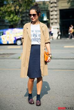 Gray graphic t-shirt, navy pencil skirt, khaki trench (rolled up sleeves), black ankle socks, oxblood loafers
