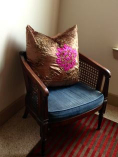 Added fem pillow to a dark masculine chair that is in the master bedroom.