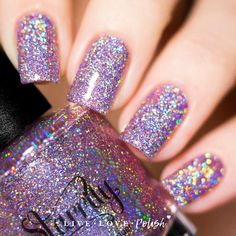 Starrily Menchie The Cat is a glitter nail polish with silver holographic microglitter in a light pink tinted base. This nail polishis designed and madein the