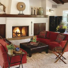 Rev Up Your Living Room with Red Punctuate a neutral color scheme with strong statement pieces like these red sofas. The classic color pulls together the adobe-style architectural elements with eastern accents like the chinoiserie screen. Red Couch Living Room, New Living Room, Living Room Furniture, Living Room Decor, Dark Furniture, Furniture Ideas, Living Room Ideas Red And Brown, Shabby Chic Vintage, Southern Living
