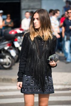 Erika Boldrin looking very sassy in this edgy boho luxe outfit. Embellished mini & fringed sweater.