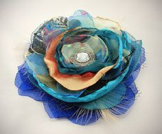 Flower Brooch, Fabric Flower Brooch, Feather, Net, Lace,Tulle, Chiffon, Satin,Organza,Teal,Turquoise, Blue, Red, Black, Gold, custom. $29.00, via Etsy.