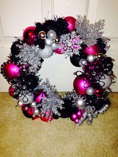 Pink black and silver ornament wreath.