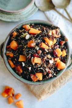 Spruce up your rice pilaf for fall with this Wild Rice Pilaf recipe with butternut squash! A delicious whole-grain salad made with wild rice, squash, almonds, cranberries and a simple balsamic vinaigrette for an easy dinner side dish or meal.
