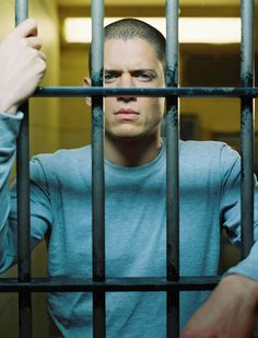 Prison Break. Michael Scofield, hands, behind bars. TV series, portrait, photo