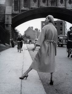 Barbara Goalen in back-belted checked Donegal tweed coat by Sybil Connolly, photo by Milton Greene on Parliament Street, Dublin, Ireland, 1953