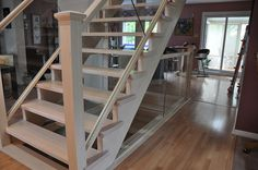 Maple and glass railing on open riser maple stair