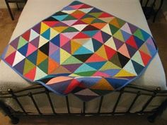 Half Square Triangle Quilt. Free pattern from Pellon. Would make a great charity quilt.