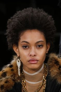 Black women hairstyles 2017 Avant Garde - Runway photo of crazy key earing natural curls-ready to wear hair- Article by Vogue