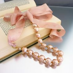 big pearls with ribbon, love the peachy pink color