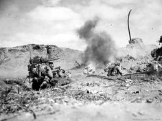 Direct frontal attack on Jap positions in rocky northern Iwo Jima. Explosions are Jap mortars landing near the tank. Gained 30 yards of grounds, loss of 30 men. Iwo Jima - February 1945