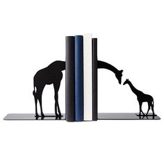 Look what I found at UncommonGoods: giraffe family bookends... for $65 #uncommongoods
