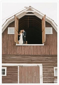 Wonderful idea for a rustic wedding-Take a photo up in the hay loft with the entire barn in view.