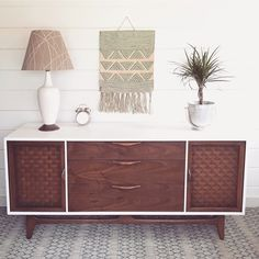 This vintage Lane dresser is painted white with natural wood doors and drawers. Use it in the bedroom, living room as a TV console, or in the dining room as a server.