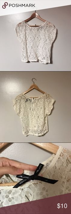 Cream Crochet/Laced Crop Top * NWOT * Perfect  Condition  * Barely been worn * No flaws * Says large but can be worn as over sized crop top for a loose fit. see through. Good for bikini cover ups or wear over bralettes  * Bundle and get a discount  * Love it? Make an offer!  * I do NOT trade  * Please feel free to comment and ask questions!! I'll be more than happy to answer !   * Top Rated Seller * Fast Shipper * Top 10% Seller * Posh Mentor Boutique Tops Crop Tops