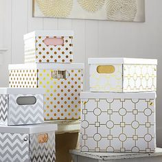 Metallic Printed Storage Bins (cute, but expensive for cardboard; consider DIY with markers or tape)