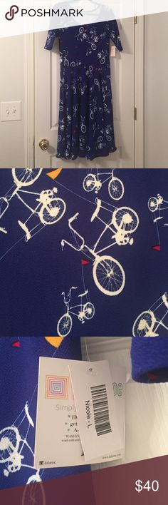 Lularoe Nicole Bicycle Dress Brand new Nicole! Fun bicycle pattern in a cobalt background. Universally flattering! Best fits a 12/14 LuLaRoe Dresses