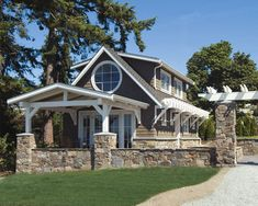 beach bungalow.  Brown exterior, white trim and fieldstone