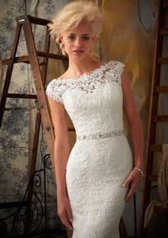 """Wedding Gowns by Morilee featuring 1901 Venice Lace Appliques on Net Removable Beaded Tie Sash (Included) Style #11009- (belt also sold separately). Colors Available: White, Ivory. Sizes Available: 2-28. Available in three lengths: 55"""", 58"""", 61""""."""