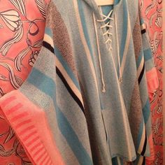Beautiful cashmere poncho...perfect over jeans & boots or a business suit. Available at Style Camp.