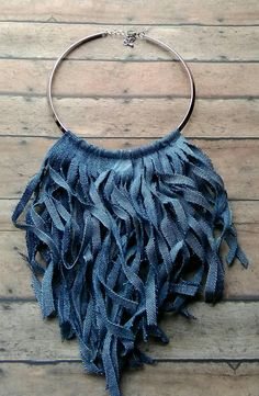 A unique denim fringe choker cut in a v-shape design available in 5 denim shades.
