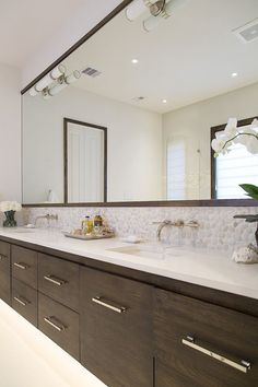 Master bathroom remodel; countertop; floating vanity; pebble tile; espresso cabinetry | Interior Designer: Carla Aston / Photographer: Tori Aston