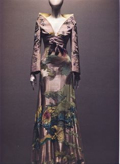 Alexander McQueen Spring/Summer 2005  Ensemble, It's Only a Game Dress of lilac silk appliquéd with silk and embroidered with silk thread; jacket of lilac silk embroidered with silk thread   Photographed by Sølve Sundsbø for Alexander McQueen: Savage Beauty