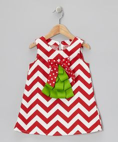 Little loves will be aglow in Christmas cheer each time they don this festive frock. As sweet as sugarplums, it boasts bold zigzags, pure cotton construction and a tree appliquécrafted from bright ribbons.100% cottonMachine wash; tumble dryMade in the USA
