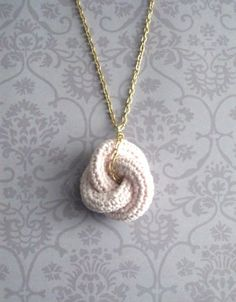 Etarnally. Crochet knot pendant in baby pink. I wonder if I can do this??
