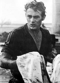"James Dean on the set of Giant during the ""oil scene""."